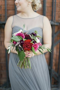Grey bridesmaid dresses are the perfect canvas for a vibrant bouquet. Photo by Melissa Oholendt Photography.