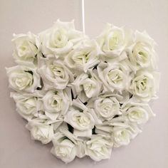 Silk ivory roses in aheart shape decoration. Decorate your wedding venue with this pretty silk rose heart shapeddecoration either hanging on a wall or placed on a table.