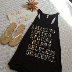 """For an  AMAZING MOTHER This is a brand new (no tags, came in one bag from my wholesaler) black tank that defines everything a Mother is Made in the USA! It's approximately 26.5"""" long and made from    95% rayon and 5% spandex. NIB Dolce Vita gold and silver sandals also for sale, bundle for a discount ‼️Price Firm unless bundled‼️         My daughters artwork not included Boutique Tops Tank Tops"""