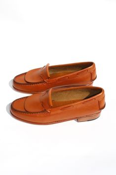 A sculptural loafer with classic elements referenced and reimagined rather than repeated. The rounded toe with fold over vamp and threaded leather tie detail are simplified to highlight the quality construction and design of this step-in shoe. Finished with streamlined moc-style stitching and