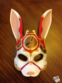 I think that this rabbit has been taken over by the Red Queen!  Steam Punk Alice in Wonderland White Rabbit Mask by senorwong.deviantart.com