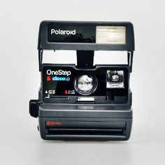 polaroid camera/film kits direct from Impossible Project -- instead of disposable cameras