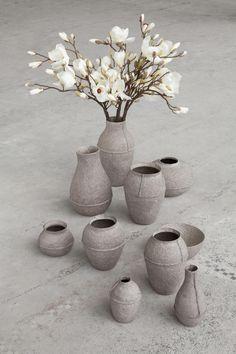Serax Maison d'être - vasi grigi e fiori di magnolia