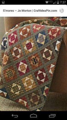 Square in a square drives me crazy, but it would look great with civil war fabric.