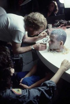 """celluloidshadows: """" Director Ridley Scott makes sure actor Ian Holm's head looks perfect for a scene from the 1979 film """"Alien"""". Click the pic to watch the scene depicted in the photo. Alien 1979, Alien Film, Alien Alien, Michael Keaton, Scene Image, Scene Photo, Chucky, Arnold Schwarzenegger, Indiana Jones"""