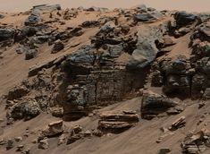 Unevenly layered rock showing a pattern typical of a lake-floor sedimentary deposit.  On Mars.