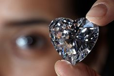 A Christie's member of staff displays an unmounted, heart-shaped, D-colour, internally flawless, type IIa diamond weighing 56.15 carats. It fetched $10,953,661 in 2011 Denis Balibouse/Reuters