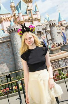 Elle Fanning Posing in a Black Top at Disneyland in Anaheim – April 2014