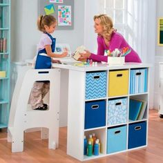 Craft Table inspiration....shelving with blue and yellow storage cubes on both ends, large wooden top