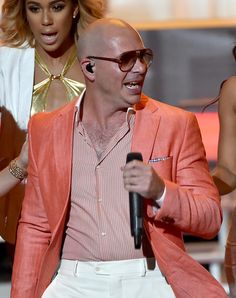 Pitbull Photos - Rapper/host Pitbull performs onstage during the 2014 iHeartRadio Music Awards held at The Shrine Auditorium on May 1, 2014 in Los Angeles, California. iHeartRadio Music Awards are being broadcast live on NBC. - iHeartRadio Music Awards Show