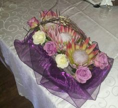 King proteas with coolwater roses Flowers by Vergeet - My - Nie www.vergeetmynieflorist.co.za