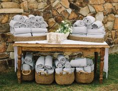 Items that beat the heat or keep your guests cozy are not only practical, they're thoughtful too. Pashminas, blankets or tins of tea are perfect for fall or winter weddings, while sunglasses, nautical beach totes and fans will get a lot of use with the hot summer sun.