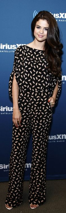 Who made  Selena Gomez's black print jumpsuit and white sandals that she wore in New York on June 29, 2013?