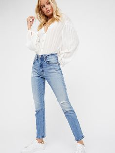 501 Skinny Jeans | The iconic Levi's 501 has been reimagined with a slimmer skinny leg and a high-rise.    * Fits straight through the hip and thigh.   * Non-stretch denim.   * Five-pocket style.   * Button fly.