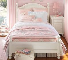 Cute Pink Poterry Barn Teen Room Design Gallery with Modern White Wood Bed Frame that have Sweet Pink Bedding complete with the Pillows Accessories ad Corner Space White Wood Bedside Table that have Cute Table Lamp also Solid Brown Wood Flooring Types