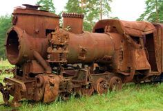 Rusty steam engine ~  Looks like a rollover.  I wonder what's going on with that dome and stack?  Some kind of recycler I guess.