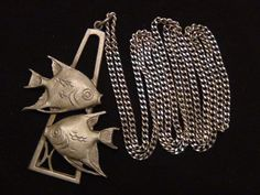 A signed cathedral pewter Pisces double fish by TheCraftyClassical, $10.00