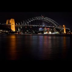 Long exposure of the Sydney Harbour Bridge at night. #sydney #sydneyharbour #sydneyharbourbridge #harbourbridge #austrailia #downtown #city #downtownsydney #harbor #harbour #bridge #steel #arch #archbridge #steelbridge #bay #icon #tourist #sight #sightseeing #longexposure #night #nightphotography #smoothwater by naturalstructure http://ift.tt/1NRMbNv