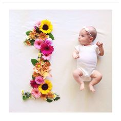 Unique idea for monthly baby photos - flowers in the shape of the corresponding month's number.