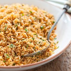 'Arroz a la Mexicana'  This is the best Mexican rice!  It has a huge garlic punch and I sometimes cut that in half.