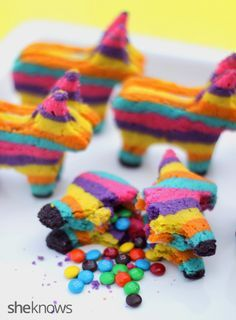 Piñata sugar cookies with a surprise inside. Do Halloween shapes with black & orange stripes for the cake walk.