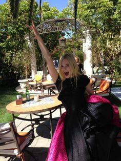ELLE FANNING HANDS UP AND AWAY