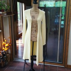 """Small Neiman Marcus duster in soft lemon EUC Small Neiman Marcus 100% cotton cardigan duster in soft lemon EUC. Length 39.5"""", bust 16.5"""" and sleeves are 25"""". Neiman Marcus Sweaters Cardigans"""