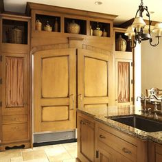 Enclosed Refrigerator using cabinet Doors. Creates a furniture hutch look!