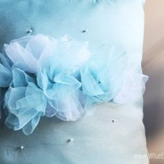 Make these pearly flowers out of sheer fabric for a romantic touch on your pillow, dress, headbands, etc.