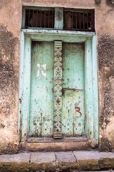 Zanzibar doors: Get to know Swahili, Arab and Indian door designs and the roots of carved wooden doors in Stone Town, Zanzibar. Top Travel Destinations, Amazing Destinations, Doors Of Stone, Indian Doors, Stone Town, Ultimate Travel, Africa Travel, Wooden Doors, Door Design