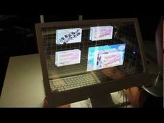 Cool! A see through 3D desk top screen. You can actually interact with the objects on the screen!!