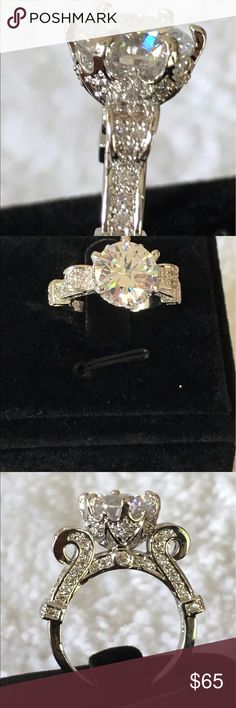 Brand new solitaire CZ diamond ring. Size 7 Brand new artisan size 7 engagement ring with large CZ diamond. Jewelry Rings