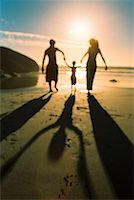 silhouette of a family at the beach