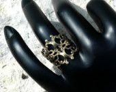 Filigree Ring   ---   Oxidized Brass Filigree Adjustable Ring - Sizes 6 to 13. $10.00, via Etsy.