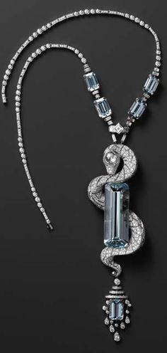 Goodness, this is a stunner! Aquamarine and diamond necklace, not sure of the hallmark...