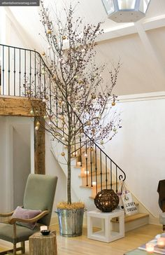Glowing votives on the stairwell add a welcoming touch. In lieu of a table runner, Brinson draped a cowhide rug over a three-drawer Louis Phillipe console.
