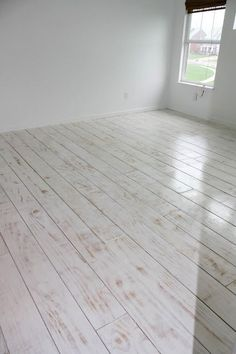 DIY PLANKED FLOORS - plywood used, whitewashed with primer, then sanded slightly.  GENIUS!