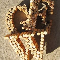 In the past we've mentioned several projects to utilize your leftover wine corks. Use them during holidays, turn them into tiles, make them into drawer pulls, and don't forget the good old cork bulletin board. Here's one more project to add to the list: cool cork letters!