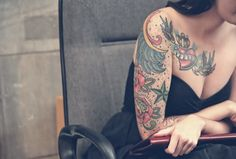 Girl with tattoos - tattoo sleeve and one above the right breast. #ink #inked #tattoo #tattoos