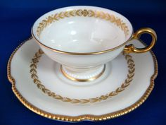 Cup And Saucer Castleton USA Aria Gold Laurel Wreath Burnished Gold Trim China Cups And Saucers, Laurel Wreath, Chinese Tea, China Dinnerware, Creamy White, Afternoon Tea, Bone China, Cup And Saucer, Tea Party