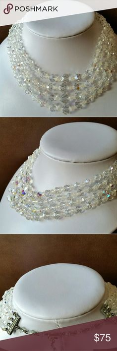 Spectacular vintage 4-strand AB crystal necklace Rare vintage 4-strand graduated Aurora Borealis necklace with all crystals intact and clasp in excellent condition. Unmarked so designer is unknown. The sparkle is unbelievable! Excellent vintage condition and ready for spring and summer events. Thanks for looking vintage Jewelry Necklaces