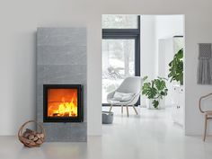 Raita S is an elegantly modern soapstone masonry heater with no extra decorative touches. You can choose from the smooth, ribbed or water-cut Grafia soapstone tiles for the surface of the fireplace. House, Interior, Interior Inspiration, Soapstone Stove, Modern, Home Decor, Interior Design, Fireplace, Standing Fireplace