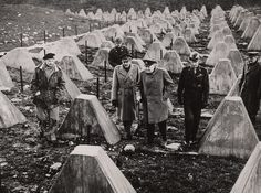 """Field Marshalls Montgomery and Brooke with Prime Minister Churchill and General Simpson among the 'Dragons Teeth"""" of The Siegfried Line in March 1945."""