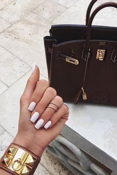 Kylie Jenner wearing  Hermès Togo Birkin Bag, Hermès Barenia Collier De Chien Cdc S Bracelet Fauve