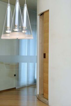 Elegant and innovative curves in interior design. Eclisse Circular is the curved Sliding Pocket Door System
