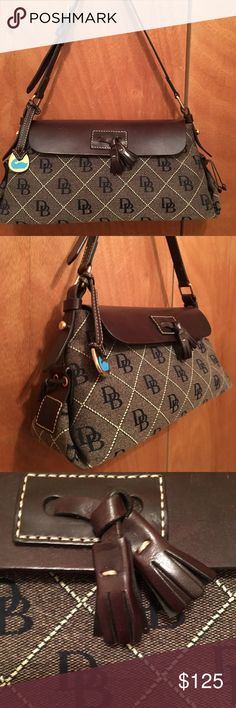 New vintage Dooney & Bourke Handbag New without tags gorgeous bag dimensions are 14x7 with adjustable strap canvas trimmed in beautiful leather with tassels 😄💜👜 Dooney & Bourke Bags Shoulder Bags
