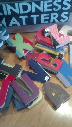 Use a jigsaw and dremmel to make letters out of old books letters cut out of old bookry cool idea especially for a spiritdancerdesigns Images