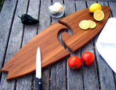 30 inch Bamboo Two Peice Surfboard Cutting Board. $49.00, via Etsy.