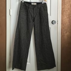 Old navy wool lined pants Grey tweed pinstripe, small zipper with button. 2 pockets in front and 2 in back.60% wool 40%rayon. Lined inside to the knee. Never worn still has the tag inside to cut off before washing or wearing. Size 6 midrise. Wide leg at bottom. Super cool pants!! Old Navy Pants Wide Leg