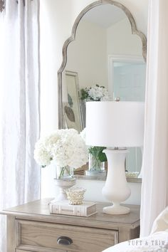 Master Bedroom Update: French Elegance/ Tuft & Trim Interior Design, mirrors over nightstands, white bedroom decor, white table lamp, nightstand styling, romantic interiors